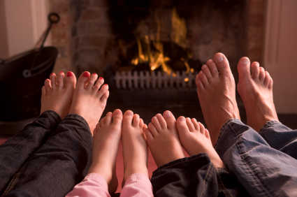 family feet fireplace